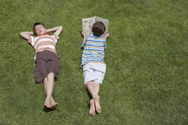 pre-teen boys on grass