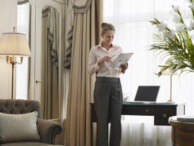 Businesswoman Reading Document