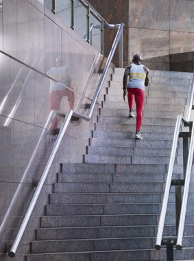 Male athlete running up steps