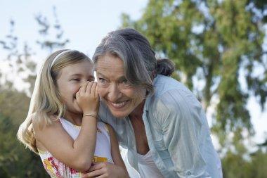 Granddaughter whispering