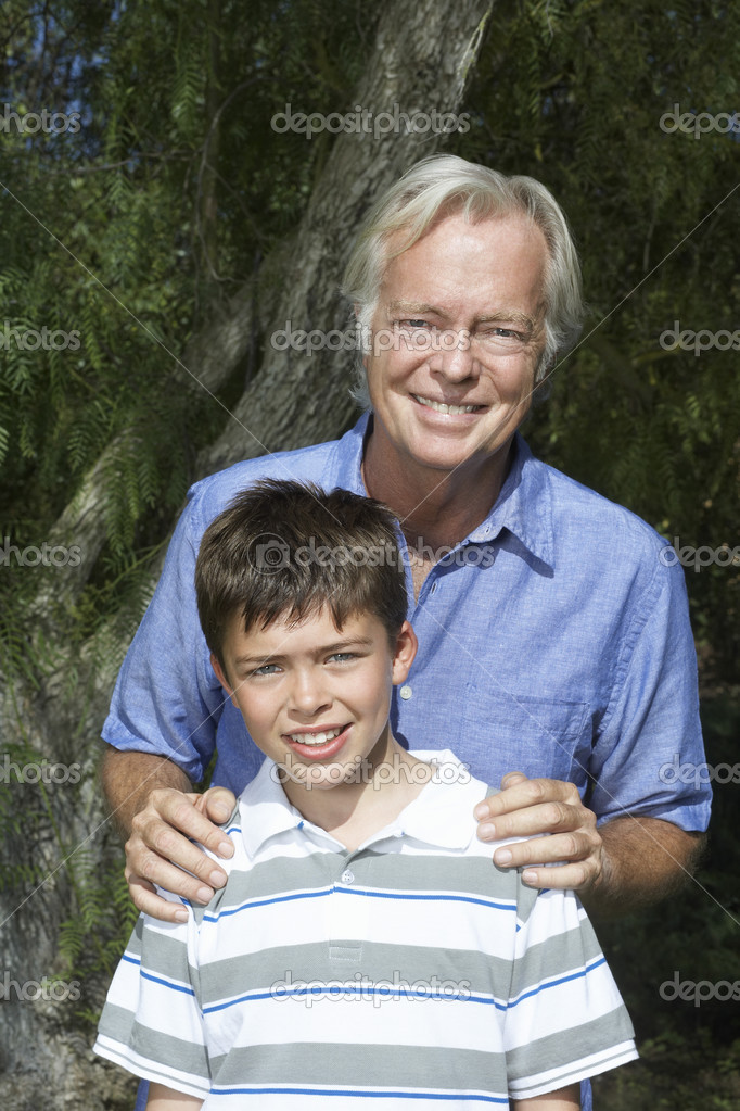 Grandfather with boy  smiling
