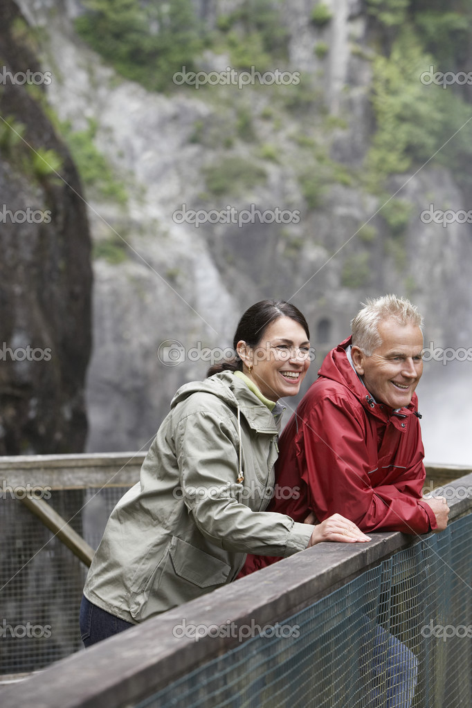 Man and woman on railing