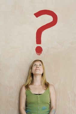 Woman Looking at Question Mark