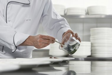 Chefs preparing salad