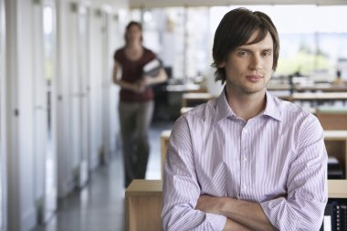 Businessman with blurred female colleague