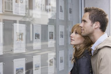 Couple Looking in Window