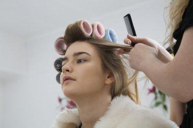 Model Having Hair Put in Curlers