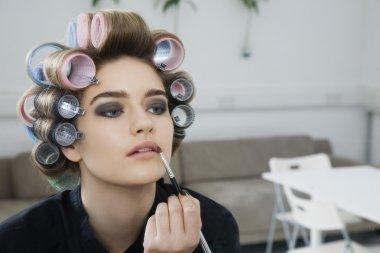 Model Applying Lip Gloss