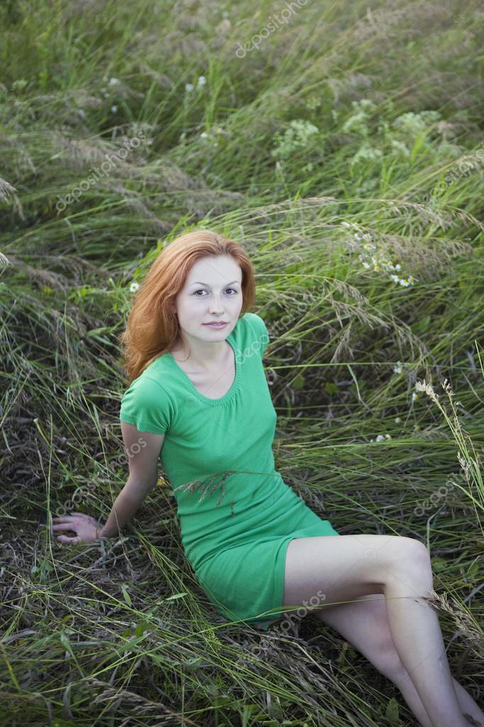 Woman Reclining in Tall Grass