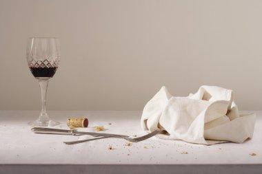 Wine glass, cutlery, dish cloth
