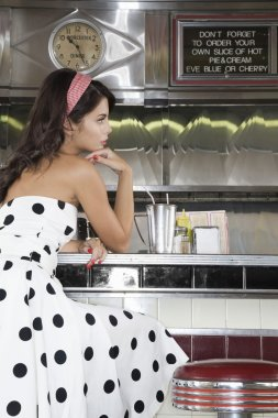 Woman Sitting at Diner Counter