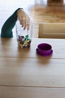 hand stealing candies