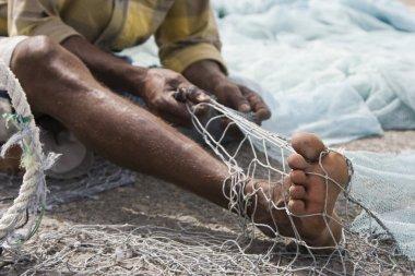 fisherman mends net