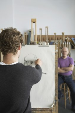 Artist drawing charcoal portrait