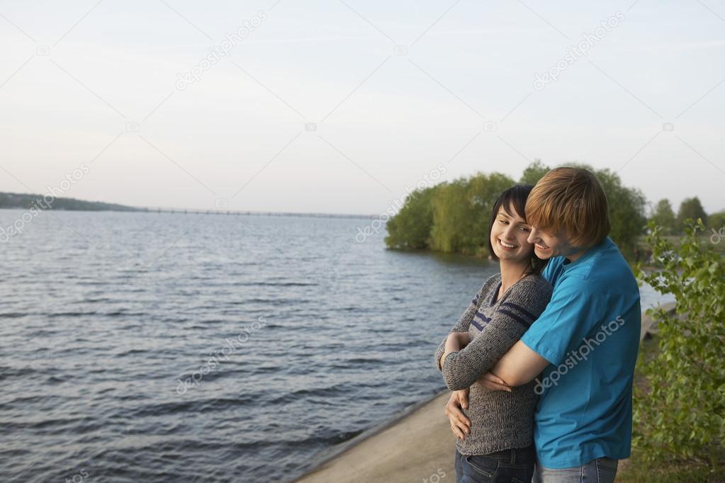 Couple Cuddling on Lakeshore