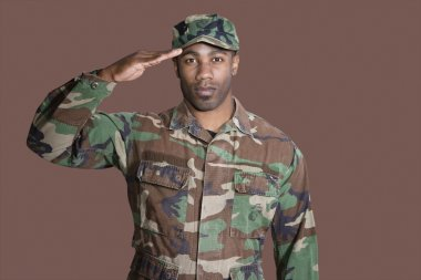 African American US Marine Corps soldier saluting