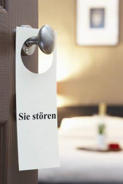 Sign hotel room door