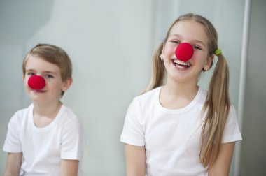 Children wearing clown noses