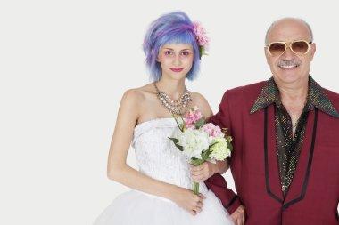Senior man with daughter in wedding dress