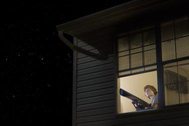 Teenage boy with telescope