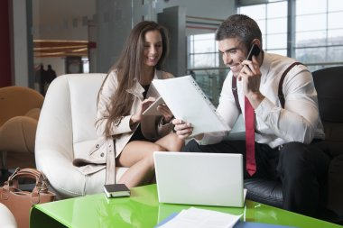 Businessman and businesswoman at meeting