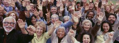 Multi-ethnic people arms raised