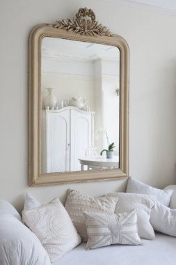 Framed mirror above daybed