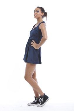 Woman wearing mini dress and sneakers