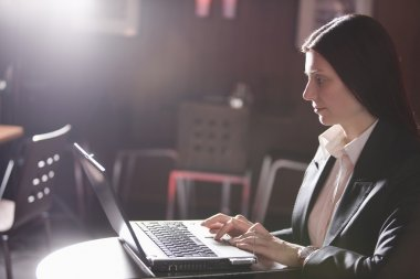 Business woman using laptop and mobile phone