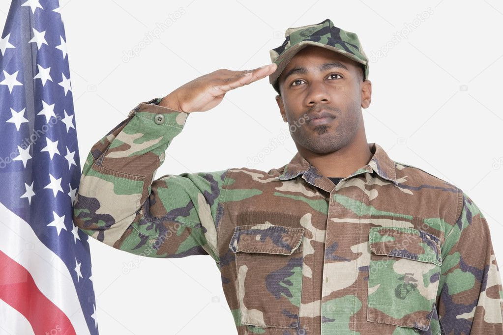US Marine Corps soldier saluting American flag