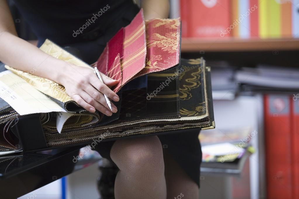 designer with sample book