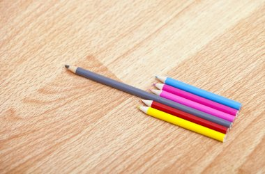 Colored pencils in a row
