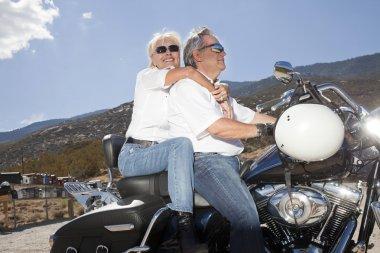 Senior couple riding a motorcycle
