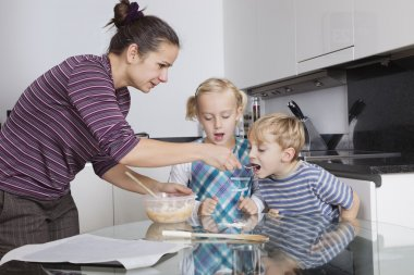 Mother with children baking