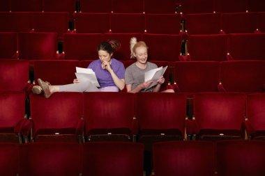Women in theatre stalls