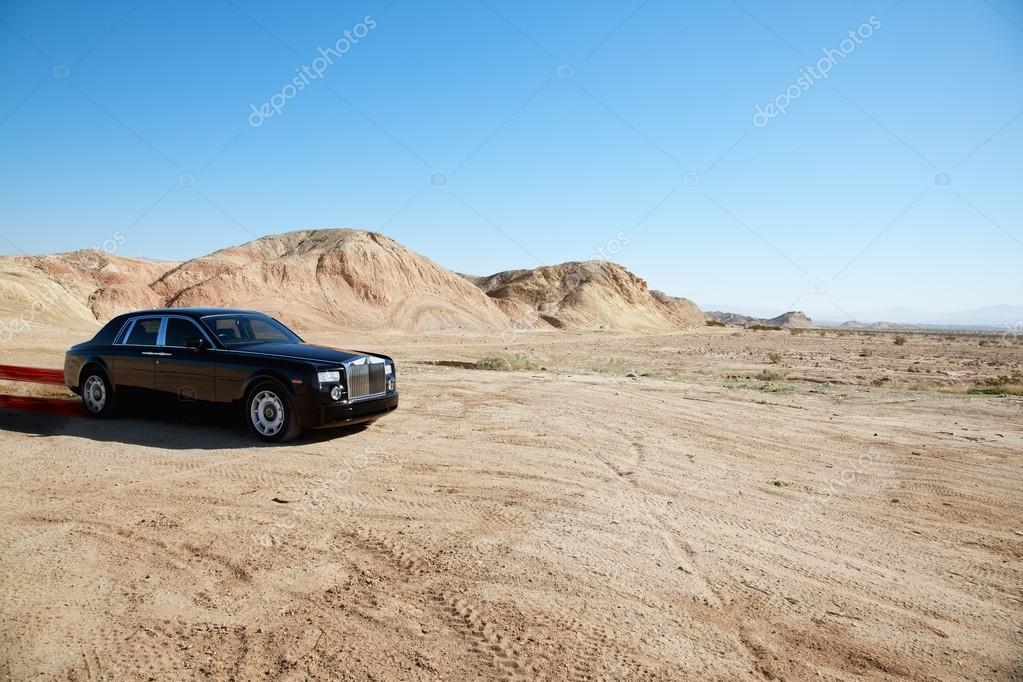 Luxurious Rolls Royce car emitting pollution