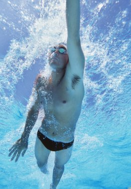 Athlete swimming in pool