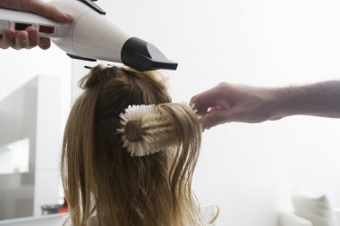 Woman in hairdressers