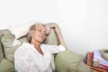 Tired senior woman sleeping