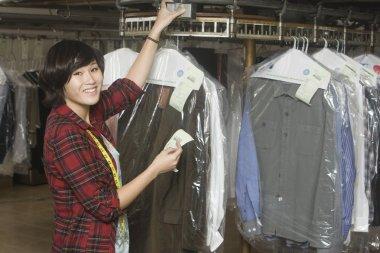 Woman working in laundrette