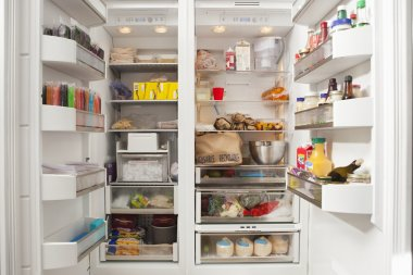 open refrigerator with food items