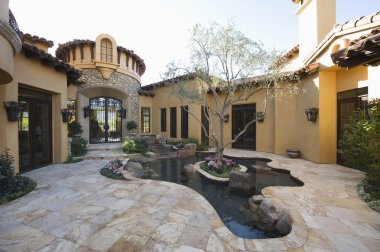 Paved courtyard garden with pool