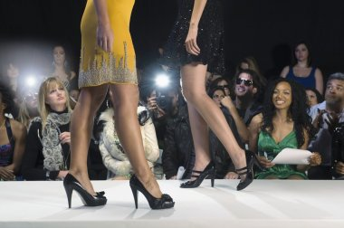 Women walking on fashion catwalk