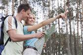 Fotografie Couple holding map