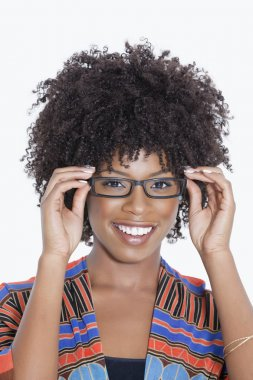 woman in African print attire wearing glasses
