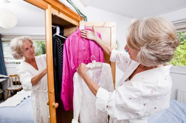 Senior woman choosing dress