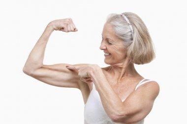 Senior woman flexing muscles