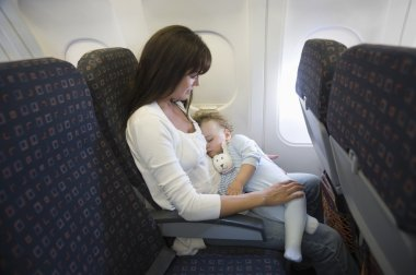 mother with baby inside airplane