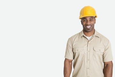African man wearing yellow hard hat helmet