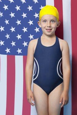 Girl in swimwear in front of American flag